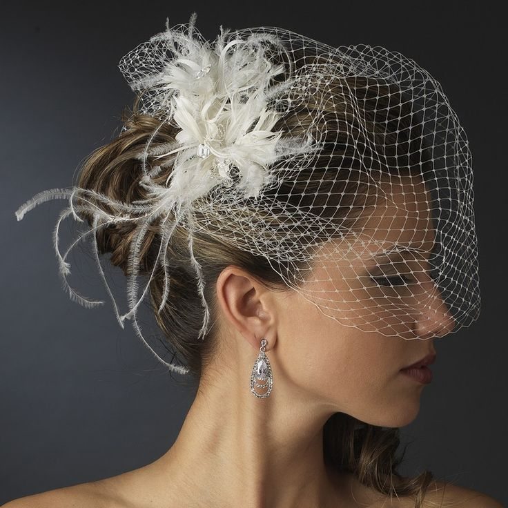 feather fascinator with birdcage bridal veil