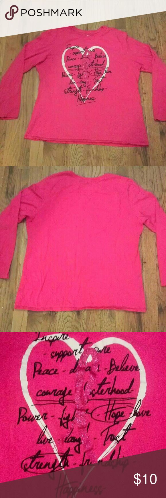 """Pink Ribbon Top Pink long sleeve top with pink ribbon for breast cancer awareness. Size XL (16-18), but seems to run a little bit small & I wouldn't suggest this if you have long arms. Ribbon is glittery/shimmery. White heart. Black writing. Sorry, I'm not sure of the brand. 100% cotton. Made in El Salvador.  Front says, """"Inspire, support, cure, peace, dream, believe, courage, sisterhood, power, fight, hope, love, live, laugh, trust, strength, friendship, happiness"""".  NO TRADES, HOLDS, OR…"""