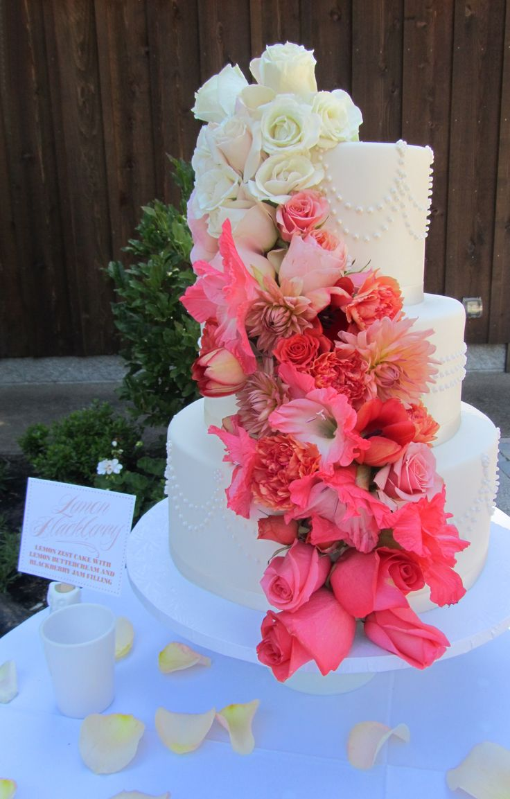 Pearls, ombre flowers, ivory chocolate fondant.  Beautiful cake