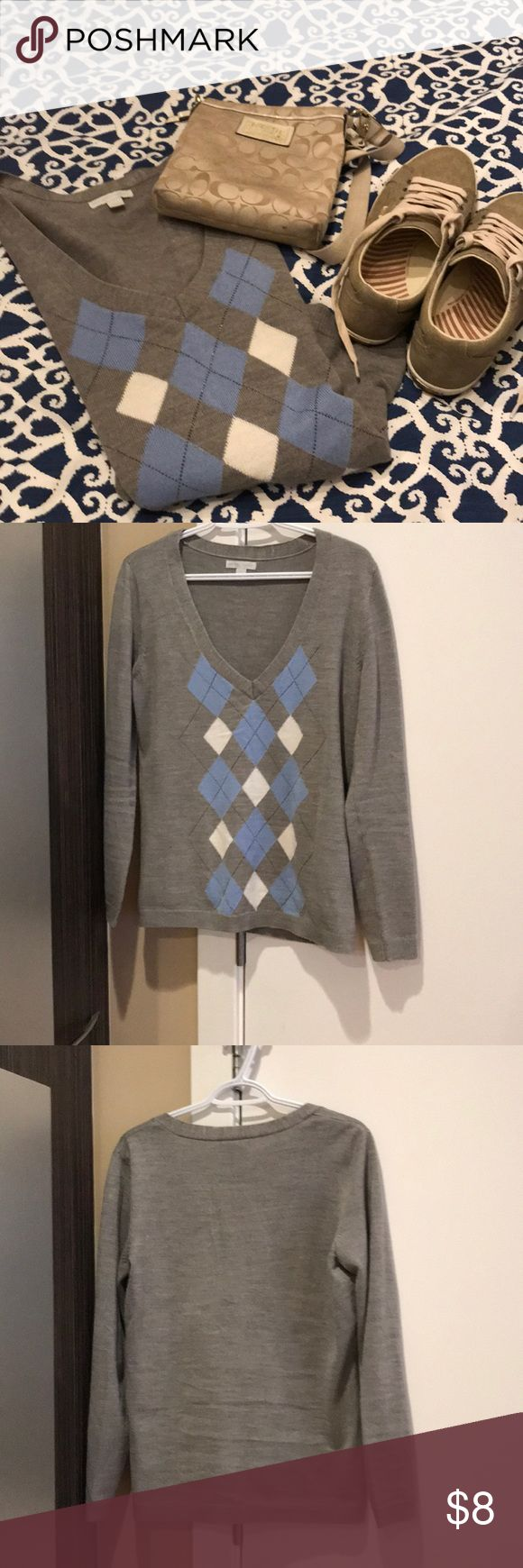 """NY & CO v-neck argyle sweater Soft and comfy argyle sweater with light blue and white pattern in front. 20"""" armpit to armpit and 24"""" neck to bottom in back. Small dots of white as shown in photo but hardly seen when on. Price reflected however. Must Bundle for price reduction. New York & Company Sweaters V-Necks"""