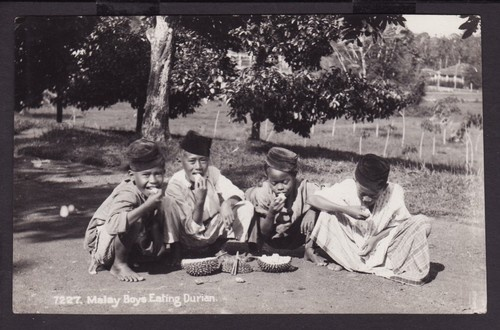 "SINGAPORE ""MALAY BOY EATING DURIAN"" c1930s REAL PHOTO POSTCARD"
