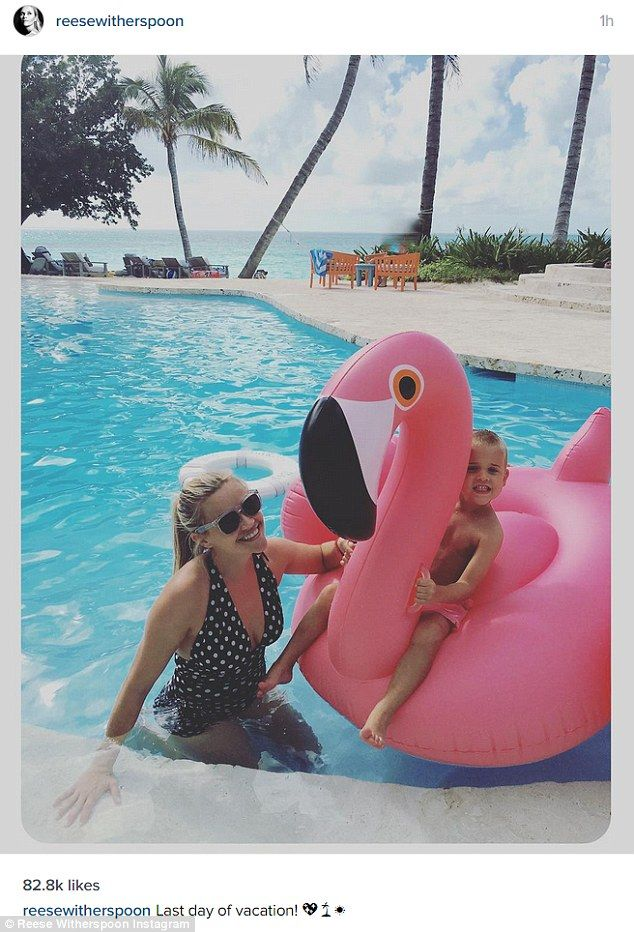 Mommy and me: Reese Witherspoon rocked a retro-style one-piece swimsuit as she posed with four-year-old son Tennessee in a photo posted on her Instagram on Sunday