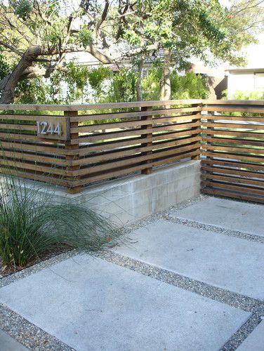 contemporary horizontal slatted fence and gate | gravel and paving driveway