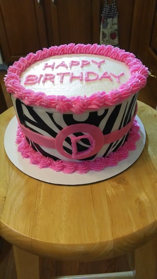 Small zebra print cake with pink accents.