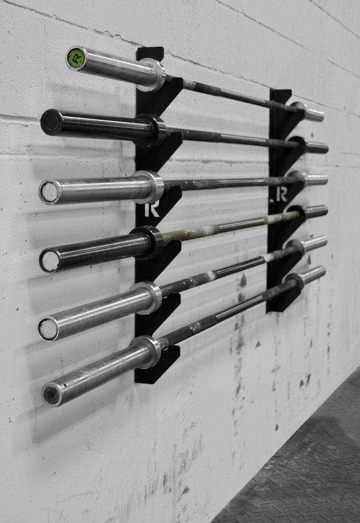 No, I do not own a gun. Nor do I have enough that would necessitate an entire gun rack...but we sure as hell do have enough barbells!