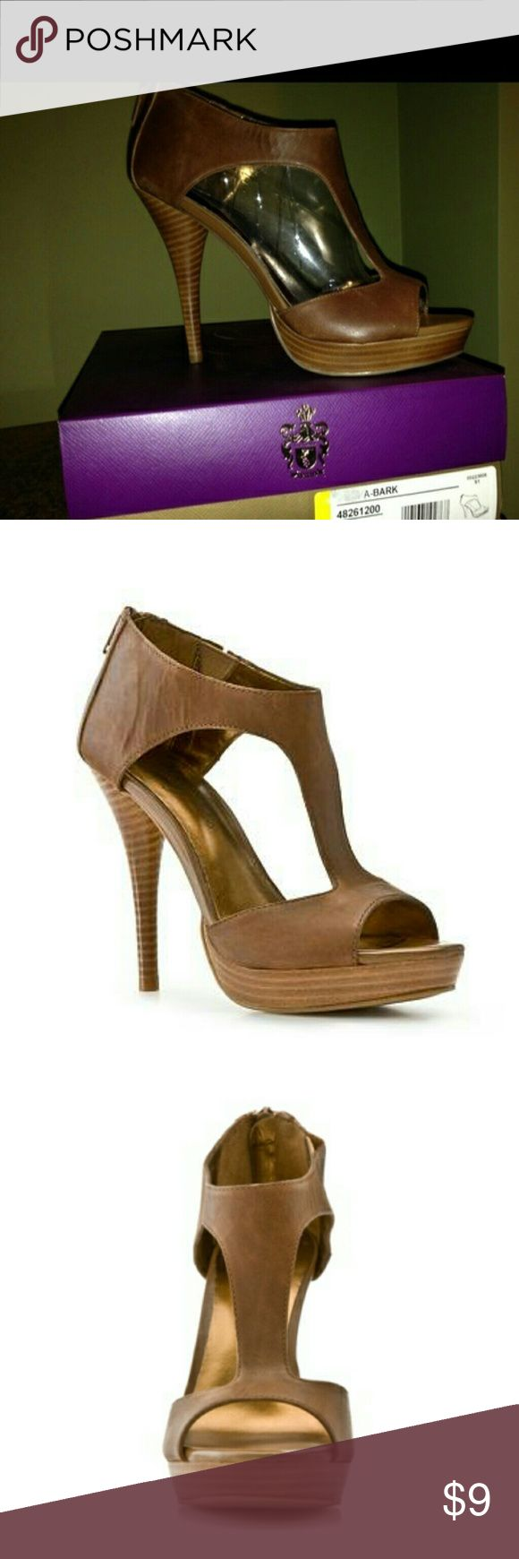 Fergie Kitana Sandals - Size: 7 In excellent condition.  Leather t-strap upper, Back zipper,  Elastic insert for added stretch 1/4 platform, 4 1/2 stacked heel, Synthetic sole Fergie Shoes