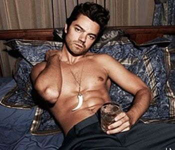 Dominic Cooper working that drink. Somehow NOBODY sees how much he looks like that oogly loser, Robbie Williams. ;)