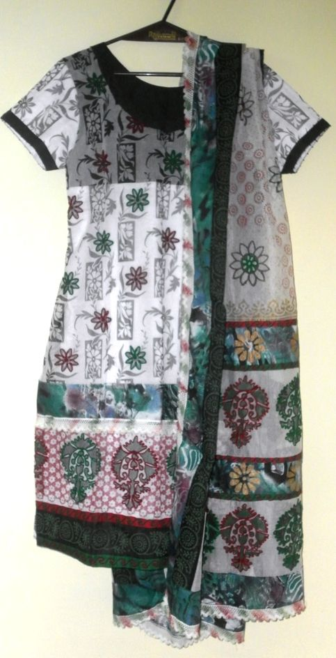 Synthetic kota Kurta, embroidery around the flowers, black lining on the bodice and white lining for the rest