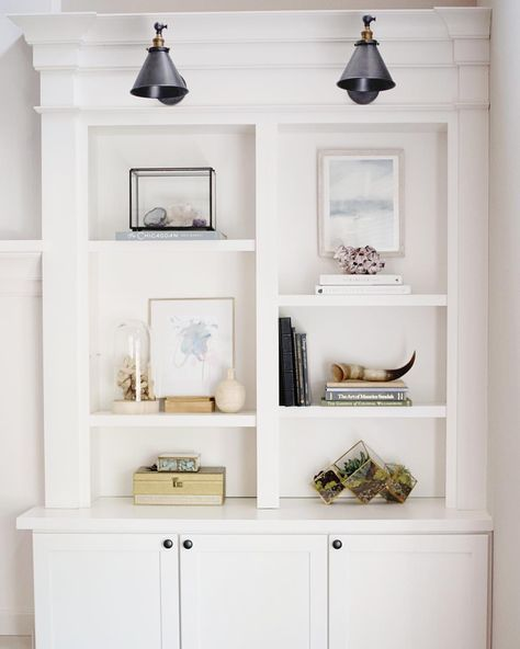 Built in classic bookshelves with simple sparse styling