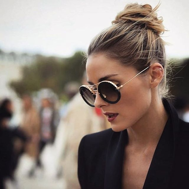 Olivia Palermo strikes a pose at Paris Fashion Week spring 2017.