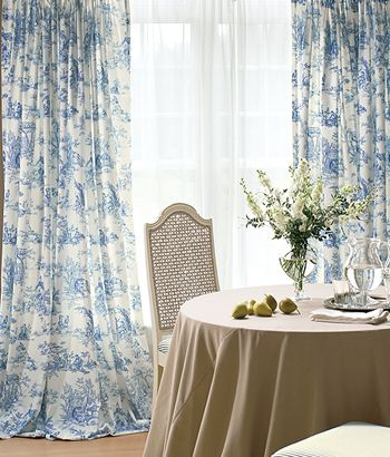 Toile in blue. :D Sweet sighhhh. I want it in an aqua, blue/green sort of colorway. Haven't found it yet. But I haven't been to Interior Fabrics in awhile either! ;-D