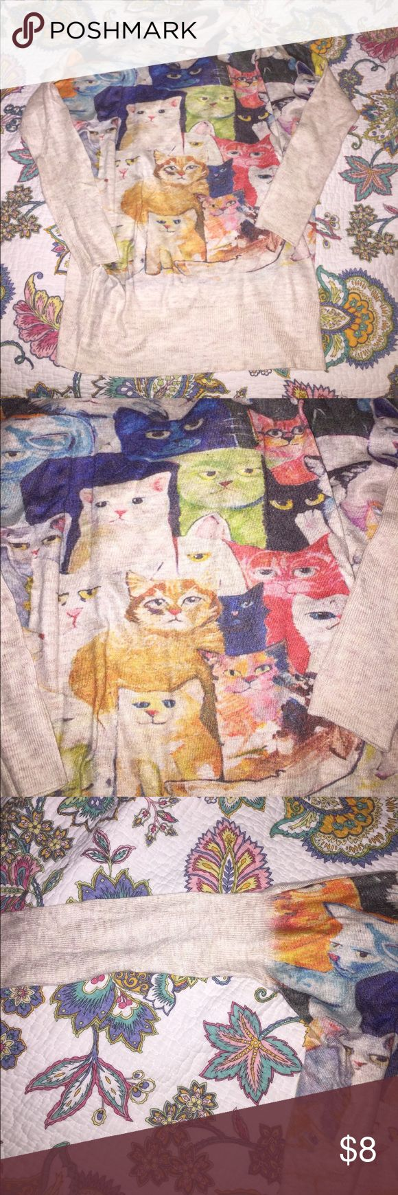 Cat sweater I bought this to make into an ugly Christmas sweater for a party but never ended up doing it. Like new condition. Riches on the arm band, size small. Perfect for a cat lover or as a joke! 😊 Sweaters