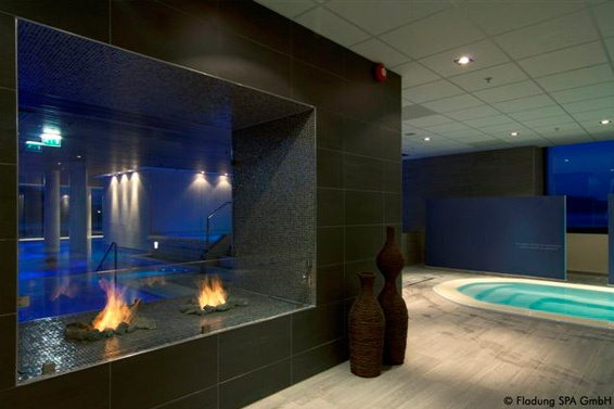 Quality Resort & #Spa with a #fireplace from #Planika