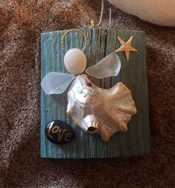 Driftwood ornament 2.5 x 3 inches. Graceful little angel made of oyster shell which has a natural barnacle which adds some character. Her head is a Cape May pebble and wings are genuine seaglass found on local beach and she has a swarovski chrystal heart. There is a real starfish