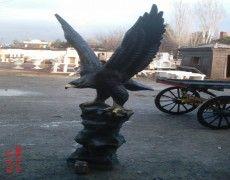 Eagle statue standing pedestal