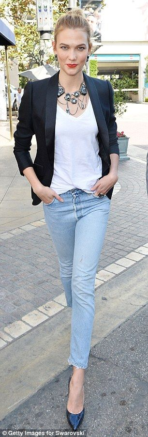 Elegantly undersated: For this event, Karlie went for chic but casual look featuring straight leg Levi jeans with a white V-neck T-shirt and a black suit jacket