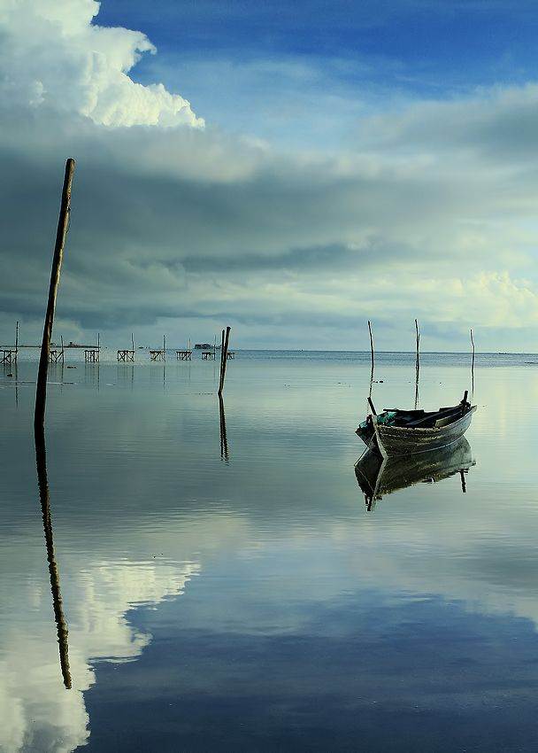 A wooden simple canoe.Water Reflections, Vincentius Ferdinand, Blue Sky Photography, Wooden Boats, Boats Photography, Beautiful, Art, Clouds Photos, Blue Sky Clouds