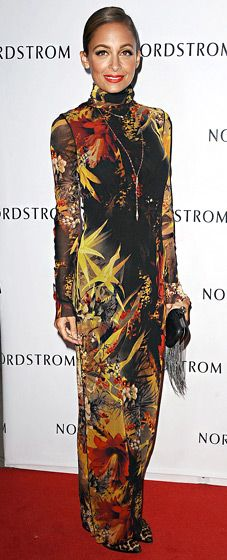was ready for fall in a long-sleeved turtleneck dress by Jean Paul Gaultier at the Nordstrom store opening.