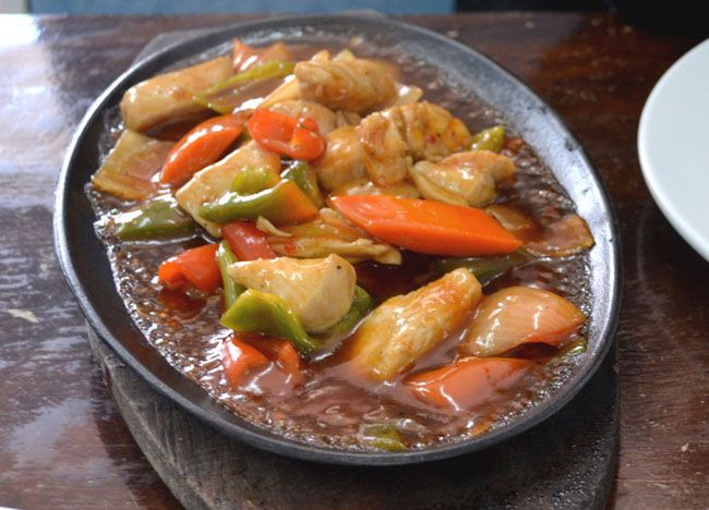 Sizzling Gambas - Top 10 Filipino Food - or our full top 10 Filipino food check here: http://live-less-ordinary.com/eating-asia/top-10-filipino-food-pinoy-food