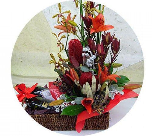 Flowers and Wine Hamper A perfect combination of red and white wine and red and colourful flowers to suit in a simple but stunning floral arrangement.#Anniversary #Hampers.http://bit.ly/1JrhQQJ