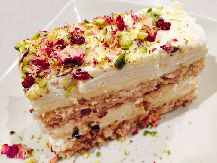 Ohhh My Geateau!! Layers of walnut gateau and meringue topped with pistachios, barberries and rose petals.