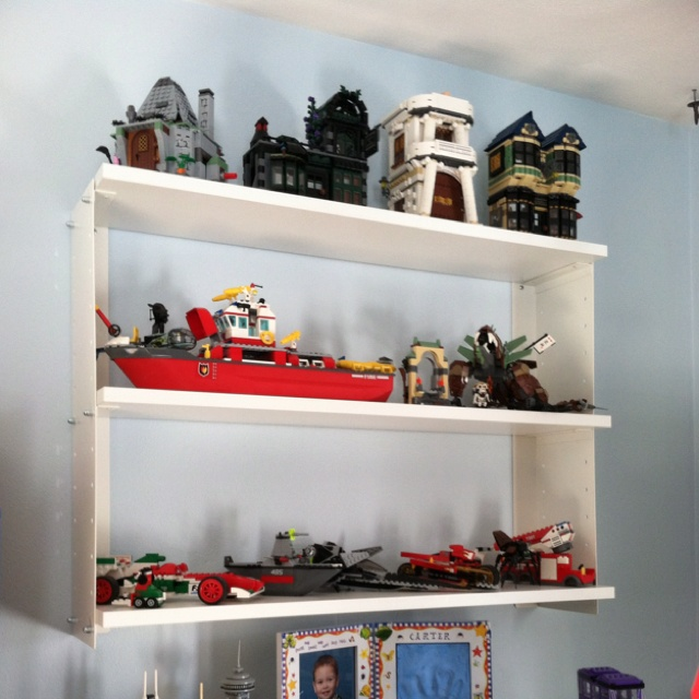 IKEA shelving for LEGO model displays...these aren't so nice but I need something to display his Lego's there getting out of control :/