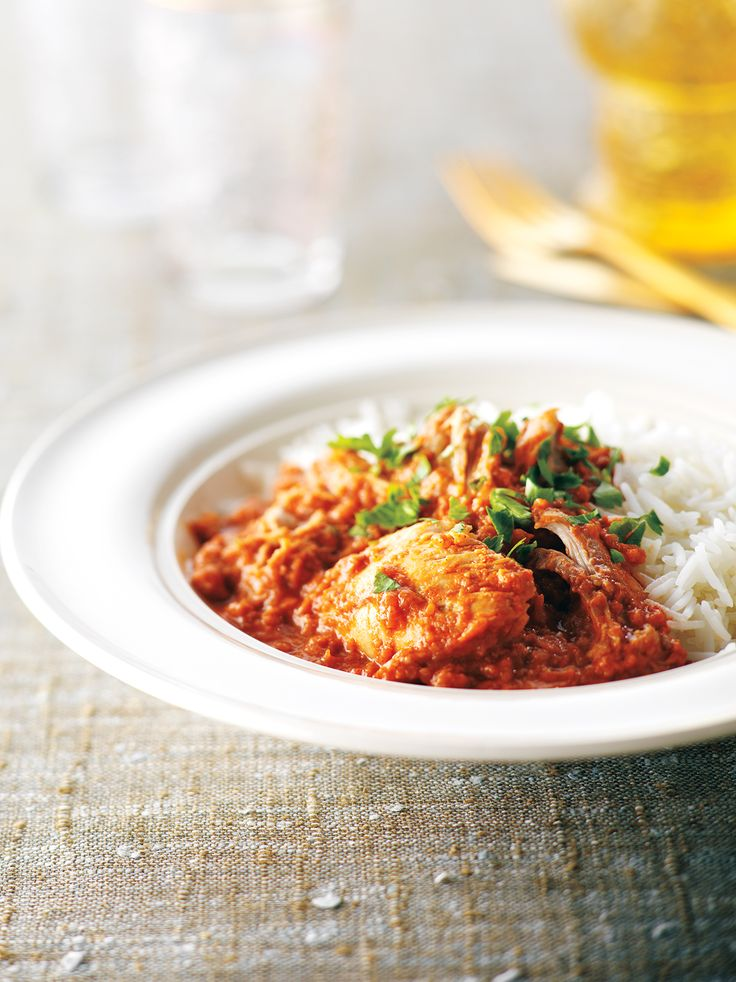 This recipe can easily be left to simmer away in a slow cooker for eight hours before adding the chicken. It yields a large quantity of sauce that freezes well if you're feeding a smaller group. Serve over hot steamed basmati rice.