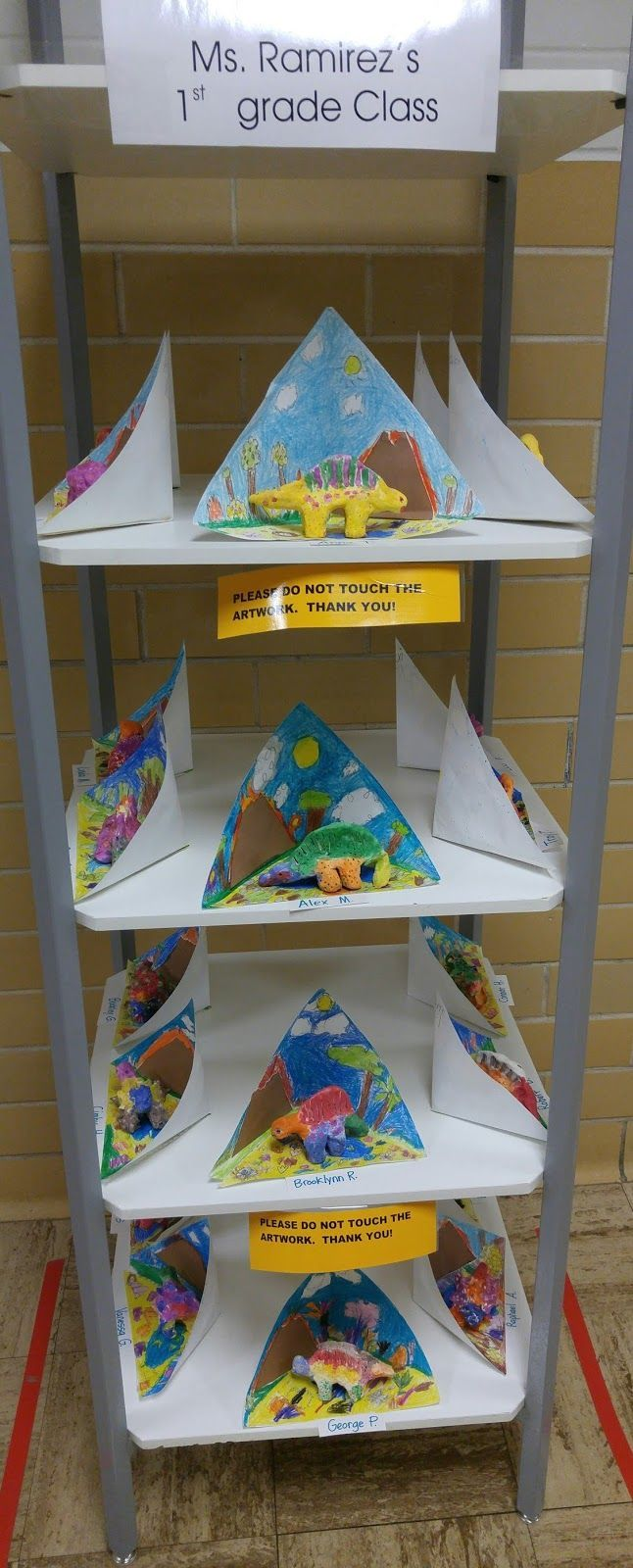 Cute way to display -- make a paper habitat for clay animals... Zilker Elementary Art Class