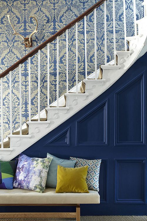 Navy + White. Love the dark blue wood work contrasted against the wall paper on the stairs.