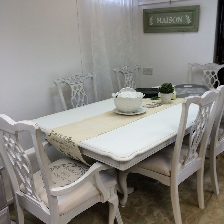 Stunning hand painted French themed dining set.  Painted in Autentico chalk paint colour Ice Cream with both clear and sparkling silver wax to give a slightly aged look without distressing.  The sparkling silver wax looks slightly grey.  Carver chairs have graphic stencilled on,behaving had fabric medium added to endure graphic is permanent and washable. Scotch guard sprayed on all seat cushions to ensure stain resistant.  More photos available at www.craftynest.co.uk