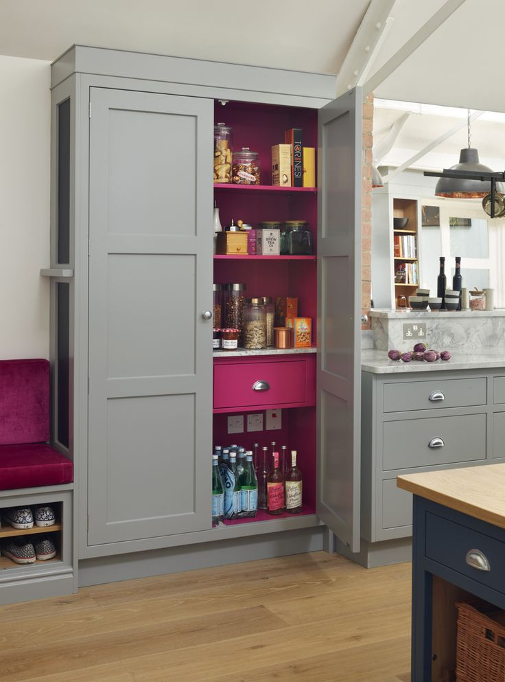 A hot pink interior adds a touch of drama to this beautifully fitted out larder cupboard in this bespoke kitchen by Martin Moore. martinmoore.com