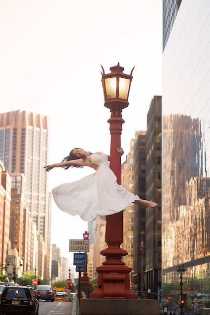 """See 18 Incredible Photos Of Dancers Soaring Above NYC #refinery29  http://www.refinery29.com/dancers-among-us-new-york-photographs#slide-1  """"This is a bridge above Grand Central. We went there looking for a city view and instead I found this amazing streetlight. I asked Karli Dinardo to hail a cab, and the wind caught her dress at just the right moment. Needless to say, not just cabs pulled over."""""""