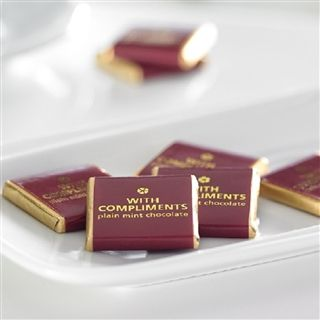 Hotel Complimentary Mint Chocolates Now you can wish your guests a good nights sleep or just welcome them, with our striking burgundy and gold foil wrapped 5g square plain mint chocolates