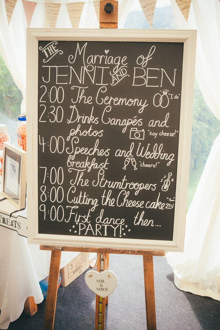 blackboard order of the day sign - Lucy G Photography - A marquee wedding with a lace gown and colour pop theme with mix and match centrepieces.