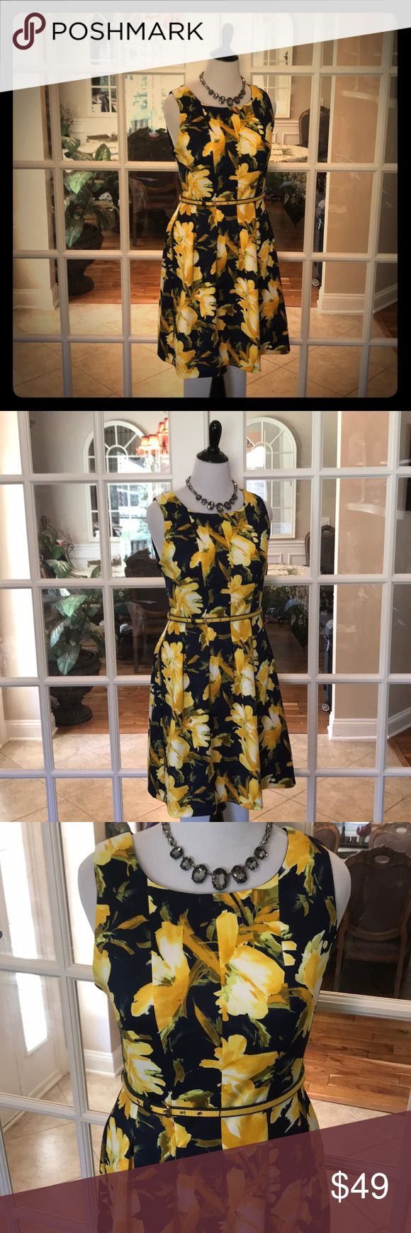 🆕 Karen Stevens Navy & Yellow Dress JUST IN‼️-  This Navy & Yellow Karen Stevens Dress is bright and colorful!  Pleated in all their right places with a navy an yellow belt, gives it a gorgeous trimming effect.   Dress has amazing stretch and is machine washable!  92% Polyester and 8% Spandex. 💞 Karin Stevens Dresses
