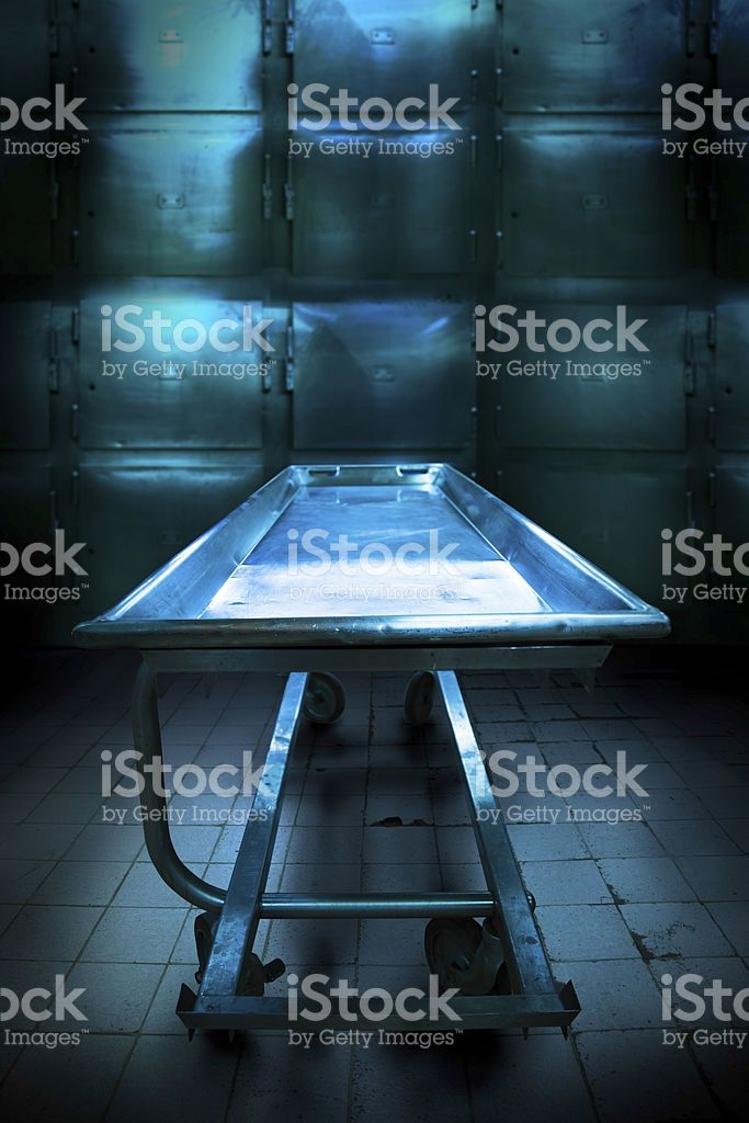 Grungy and high contrast photo of morgue trays royalty-free stock photo