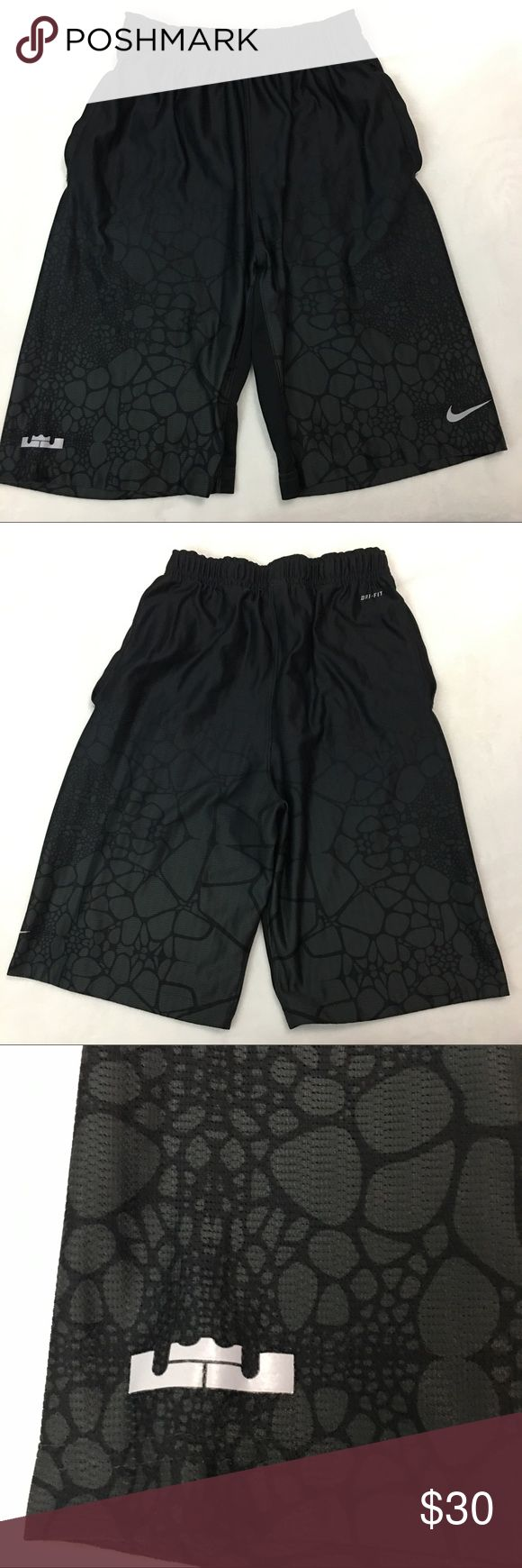 """Nike Dri-Fit Lebron James Basketball Shorts Size L This is a pair of men's Nike Dri-Fit Lebron James Black Basketball Shorts Size Large. These shorts are still in excellent gently used condition with no stains or any visible defects. Measurements are as followed: Waist: 12"""" Unstretched Inseam: 10 1/2"""". Please take a look at all photos for condition and if you have any questions feel free to ask. Nike Shorts Athletic"""
