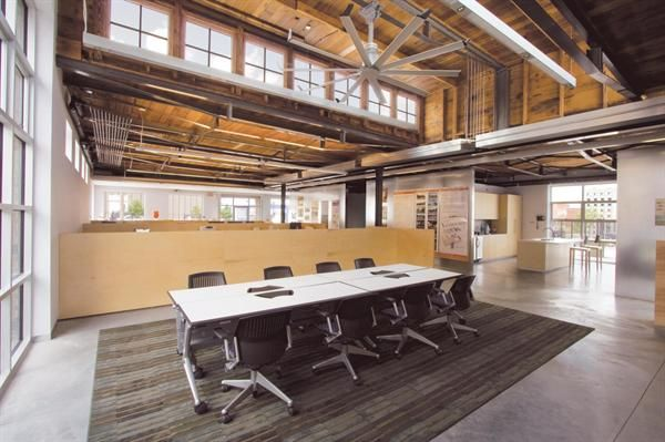 Modern open office space with exposed ceilings REAlign Tenant
