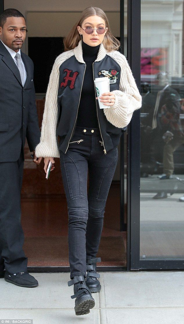 Stomping through: Gigi Hadid left her New York City apartment wearing combat boots on Thur...