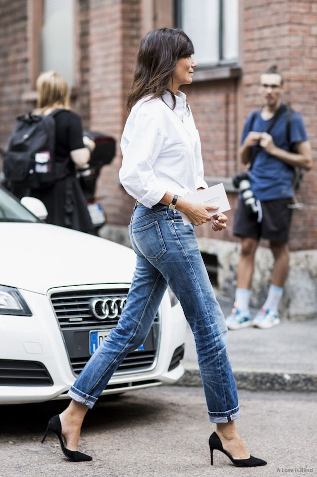 Emmanuelle Alt in a white button down, cuffed jeans & black heels #style #fashion #streetstyle