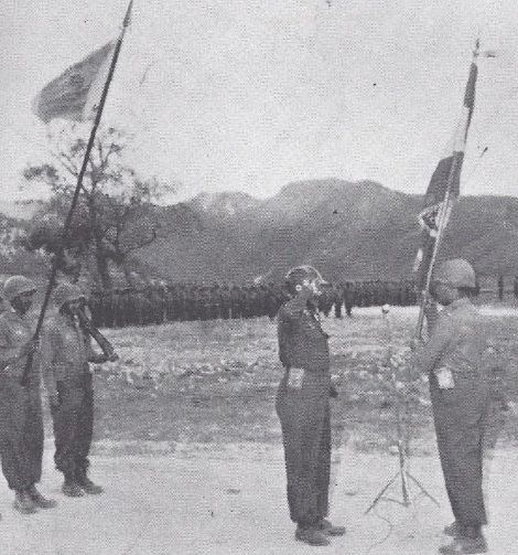 (The commander of the second Kagnew battalion turns over the national flag to the commander of the third. The actual physical Ethiopian flag taken to Korea was from the imperial palace.)