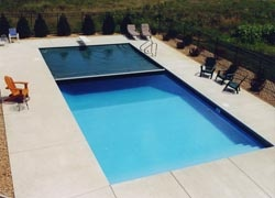 hidden, automatic pool cover could be the perfect solution: easy on/off, keeps leaves and dirt out, nice looking when on.  Preferably pool blue.