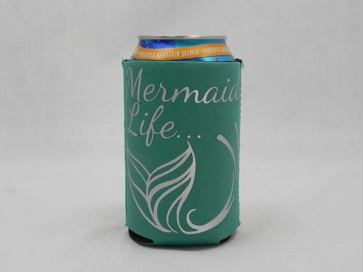 """Teal koozie with """"Mermaid Life"""" imprint with mermaid symbol in silver script. Great for soda, beer, juice and other canned beverages, our custom koozies will keep your hands warm and dry while your dr"""