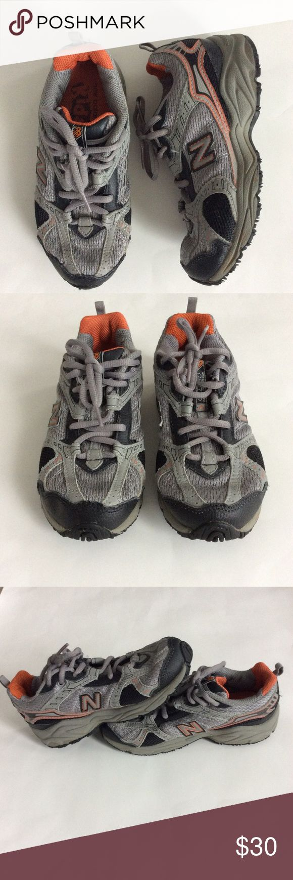 👫New Balance All Terrain Tennis Shoes New Balance All Terrain Tennis Shoes. Grey, black, orange colors. Lace up. Size 1 Kids. Great condition with normal wear. New Balance Shoes Sneakers