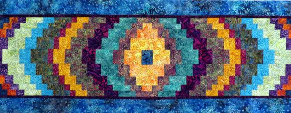 A bright bold collection of beautiful batik fabrics create this large quilted table runner/bed runner. Created using a bargello quilt pattern