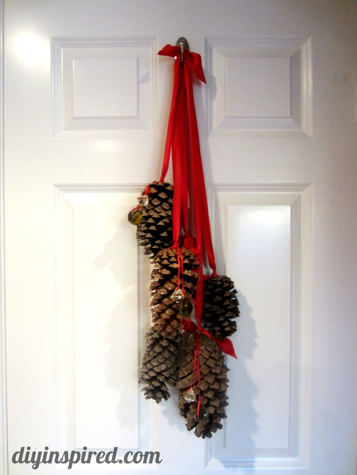 Hanging pine cone decoration 2 christmas pinterest for Pine cone door decoration