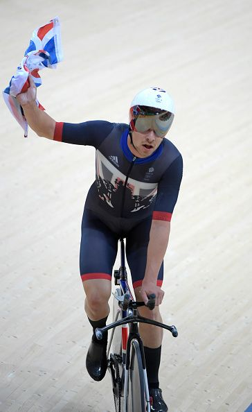 Owain Doull of Team Great Britain celebrates after victory in the Men's Team…