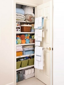 This gives me a great idea!  Hang rods on inside of closet doors in guest bedrooms for blankets and sheets.