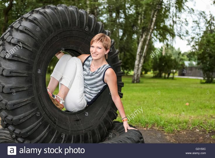 Download this stock image: The girl at the wheel of a large truck - G3150C from Alamy's library of millions of high resolution stock photos, illustrations and vectors.