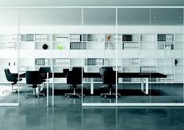 Modern office furniture NYC Affordable Office Furniture Companies Decorating Ideas Transparent Glass With Curved Design Completed White For Office Keyboard Shelf And Silver Panel Near Small Steel Legs Stylish Look Of Office Furniture Nyc.
